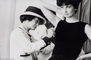 Coco Chanel works on tailoring a piece on a model in 1962.  Image courtesy of Daily Mail UK.