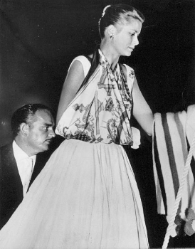 Princess Grace wears a Hermès scarf as a sling, 1956.