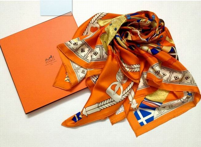 Hermès scarf and iconic orange box.