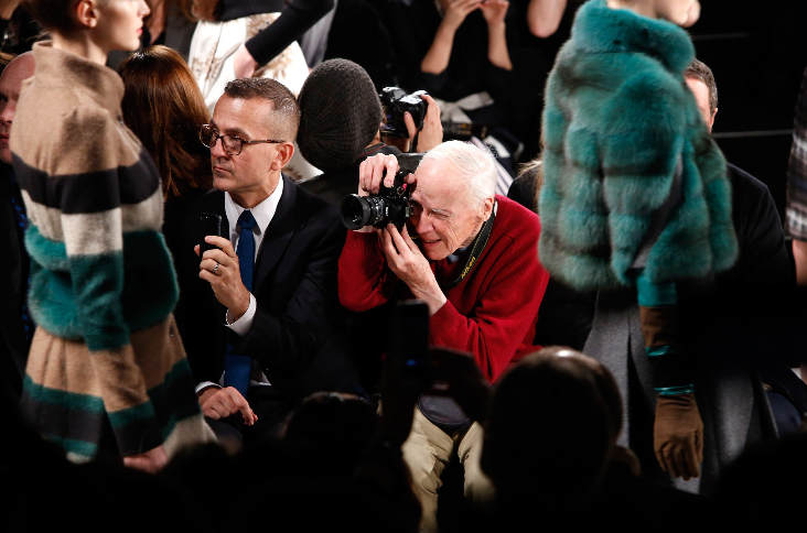 Bill Cunningham at a Mercedes-Benz fashion show.  Image courtesy of nytimes.com.